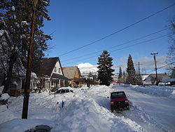 Deep snow in McCloud, with Mount Shasta in the background