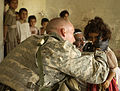 Medic Aids Iraqi Child DVIDS28503.jpg
