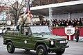 Ministru prezidents Valdis Dombrovskis vēro Nacionālo bruņoto spēku vienību militāro parādi 11.novembra krastmalā (6357916961).jpg