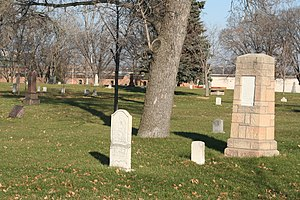 Minneapolis Pioneers and Soldiers Memorial Cemetery - Pillar on right is marker for Charles W. Christmas (1798-1904), first county surveyor of Hennepin County, Minnesota.