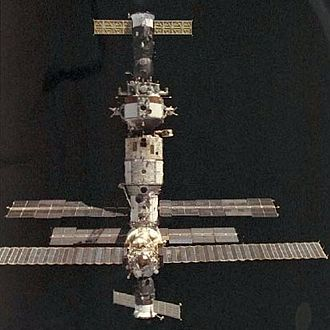 Soyuz TM-20 - Mir as seen from Space Shuttle Discovery during STS-63, with Soyuz TM-20 seen at the top