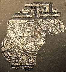 Lion from the Staufer era as a mosaic fragment in the south aisle