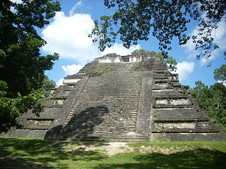 Mundo Perdido, Tikal - Temple 5C-49 features prominent talud-tablero architecture, a style associated with Teotihuacan