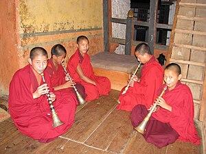 Lingm - Monks playing dong lingm at Lhuentse Dzong