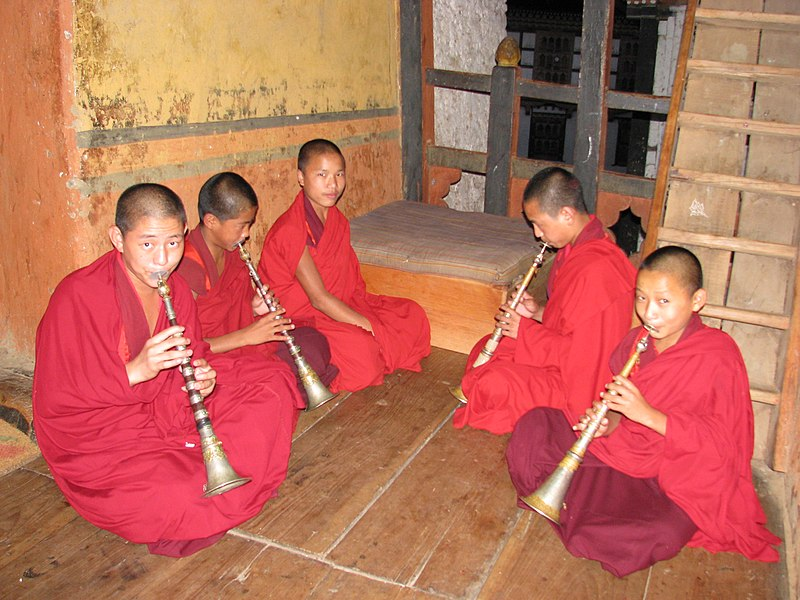 Monks playing lingm at Lhuentse Dzong