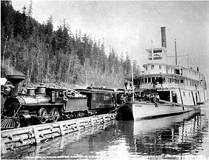 Nakusp (sternwheeler) - Nakusp meeting train of the Columbia and Kootenay Railway on the inclined wharf at Robson