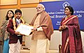 Narendra Modi presenting the National Bravery Awards 2015 to the children, in New Delhi on January 24, 2016. The Union Minister for Women and Child Development, Smt. Maneka Sanjay Gandhi is also seen (11).jpg