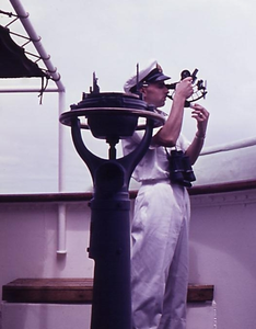 Navigation officer takes the sun's altitude with the sextant.png