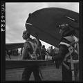 Navy pilots head for ready room after landing their planes on USS Yorktown CV-10. - NARA - 520947.tif