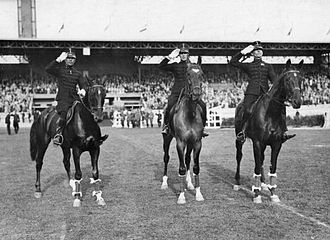 Equestrian at the 1928 Summer Olympics - The Netherlands won the team eventing gold medal and are saluting the audience