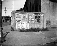 New Orleans 1920 Posters on Wall of Old St Anthony Church.jpg