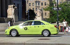 "Boro taxi - An apple green ""Boro Taxi"" hits the streets in the Bronx."