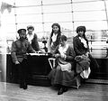 Nicholas II with his daughters aboard the Standart.jpg
