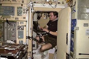 Russian Orbital Segment - Nikolai Budarin (a cosmonaut) works inside one of the crew quarters aboard Zvezda service module