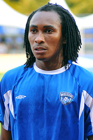 Photo of a player in blue football kit, hair braided.