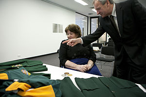 Daphne Ceeney - Australian Paralympic Committee President and Daphne Hilton (née Ceeney) view the blazers and medals Hilton donated to the APC in 2012