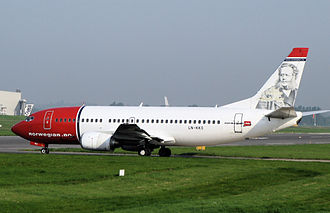 Norwegian Air Shuttle - Boeing 737-300 taxiing to the runway, with Henrik Ibsen depicted on the fin