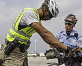 Officer Ramon Colon, with the Metropolitan Police Department of the District of Columbia (MPDC), conducts bicycle training for new MPDC recruits at Joint Base Anacostia-Bolling in Washington, D.C., Aug. 27 130827-N-WY366-006.jpg