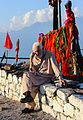 Old man sitting at the shrine of Pir Shah Hussain Bukhari's shrine.jpg