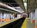 Outbound train arriving at Sullivan Square station, July 2015.JPG