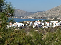 Overlooking Pefkos from Nico's Restaurant , Lardos beach on the horizon across the bay - panoramio.jpg