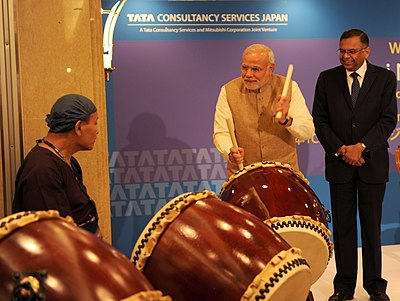 PM Modi plays drums at the inauguration of the TCS Japan Technology and Cultural Academy, in Tokyo.jpg