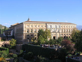 Exterior of The Palace of Charles V in Granada was built upon his wedding to Isabel of Portugal in 1526. Palacio Carlos V west.jpg