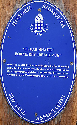 "Elizabeth Barrett Browning - Blue plaque outside ""Belle Vue"" in Sidmouth, Devon, where Elizabeth Barrett lived with her family from 1833 to 1835"
