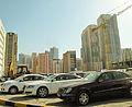 Parking, cranes, bulldozers, buildings (8720810886).jpg