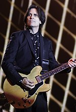 Paul McCartney - Out There Concert - Rusty Anderson 2014(cropped).jpg