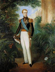 Full-length painted portrait of a blond young man standing in a garden dressed in white trousers, a military tunic with heavy gold braid, a blue sash of office, and holding a bicorn admiral's hat