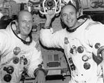 Pete Conrad (left) and Al Bean pose in the LM simulator at the Kennedy Space Center.jpg