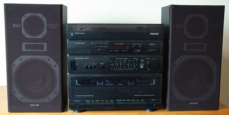 A stereo system with a turntable and dual cassette deck