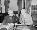 Photograph of President Truman at his desk in the Oval Office with Secretary of State Dean Acheson, discussing... - NARA - 200263.tif