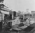 Photograph of the wreckage of the USS Downes, hit by bombs during the attack on Pearl Harbor - NARA - 306547 - cropped.png