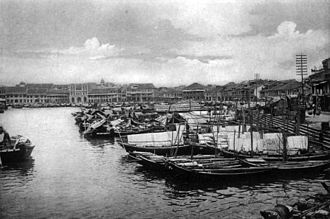 Singapore River - Boat Quay along the banks of the Singapore River, circa 1900s