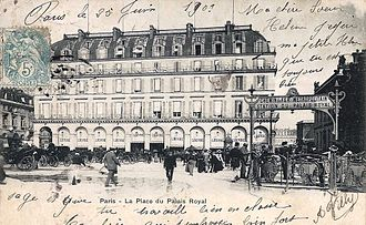 "Paris Métro entrances by Hector Guimard - Palais Royal station (right) on a 1903 postcard; the Guimard entrance has yet to receive the arch with lights and ""Métropolitain"" sign, and instead is identified by a temporary wooden sign."