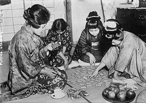 Uta-garuta - Uta garuta being played by women in traditional dress