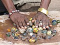 Polishing of Ghanaian glass beads.JPG