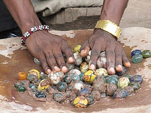 Powder glass beads - Polishing of Ghanaian glass beads. Cedi bead factory, Odumase Krobo, Ghana