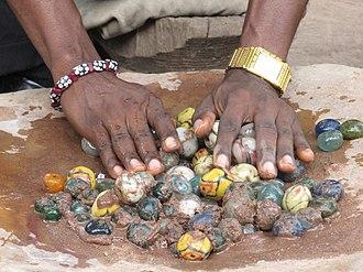 Powder glass beads - Polishing of Ghanaian glass beads. Cedi bead factory, Odumase Krobo, Ghana