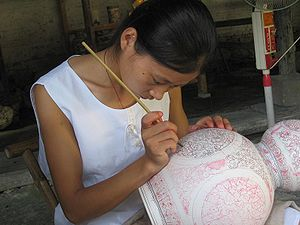 Decorating porcelain at modern-day Jingdezhen.