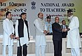 Pranab Mukherjee presenting the National Award for Teachers-2012 to Mohammad Azijur Rehman Salfi, Bihar, on the occasion of the 'Teachers Day', in New Delhi. The Union Minister for Human Resource Development.jpg