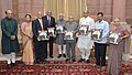 Pranab Mukherjee received the first copy of the Coffee Table Book 'The Nationalist President Pranab Mukherjee', edited by Shri Prabhu Chawla, at Rashtrapati Bhavan, in New Delhi. The Vice President, Shri Mohd. Hamid Ansari.jpg