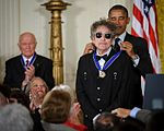 President Barack Obama presents American musician Bob Dylan with a Medal of Freedom.jpg