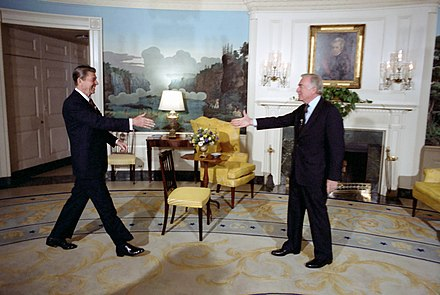 Cronkite meets with President Ronald Reagan at the White House, 1981 President Ronald Reagan greeting Walter Cronkite for an interview in the Diplomatic Reception Room.jpg