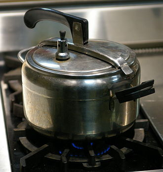 Pressure cooking - A pressure cooker. The regulator is a weight on a nozzle next to the handle on the lid.