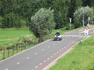 Driving an ATV on a paved road in the Netherlands Quad bike on public road in Netherlands.JPG