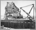 Queensland State Archives 3638 End elevation of north anchor arm yard crane loading supply car Brisbane 2 June 1938.png