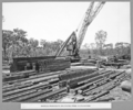 Queensland State Archives 3707 Rocklea workshops unloading steel in stockyard Brisbane 8 October 1936.png